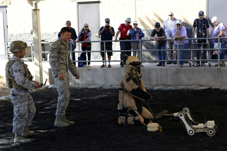 Airman 1st Class Zachary Riesselmann, 56th Civil Engineer Squadron explosive ordnance disposal technician (left), and Senior Airman Daniel Keum, 56th CES EOD technician, demonstrate how to operate a micro tactical ground robot at Luke Air Force Base, Ariz., Oct. 28, 2017. Additional EOD equipment was showcased during the Retiree Appreciation Day event held at the Navy Operations Support Center. (U.S. Air Force photo/Airman 1st Class Pedro Mota)