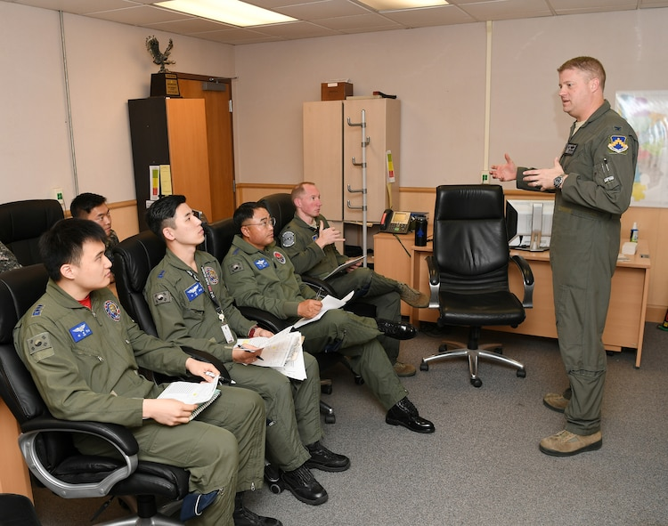 """Col. David G. Shoemaker, """"Wolf"""", 8th Fighter Wing commander, reviews mission plans with U.S. Air Force and Republic of Korea Air Force pilots during the """"Friendship Flight"""" mission pre-flight brief at Kunsan Air Base, Republic of Korea, Oct. 30, 2017. The """"Friendship Flight"""" continued a long history of various joint training missions focused on strengthening partnerships and capabilities between the two nations, ensuring combined combat readiness on the Korean Peninsula."""