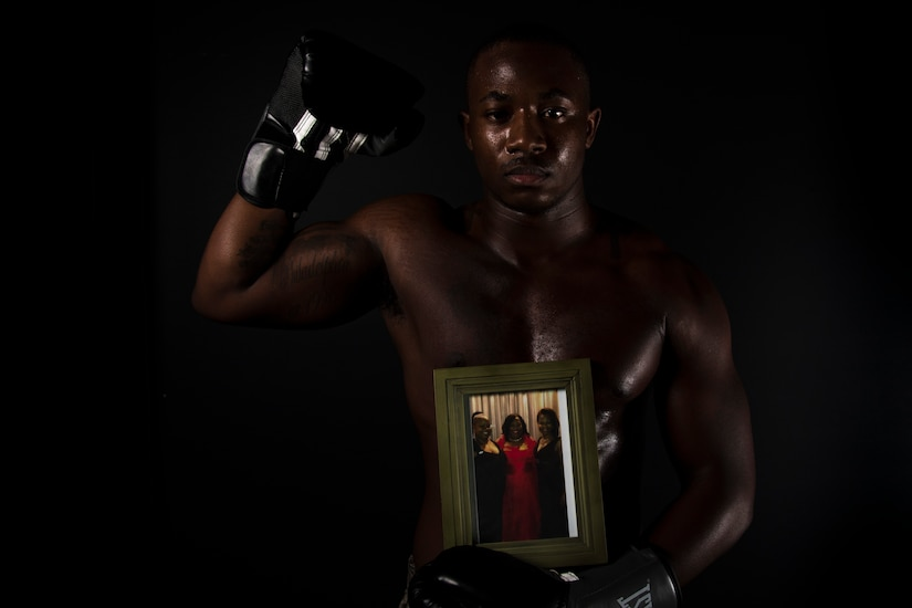 Airman 1st Class Isaiah Randall poses in boxing attire.