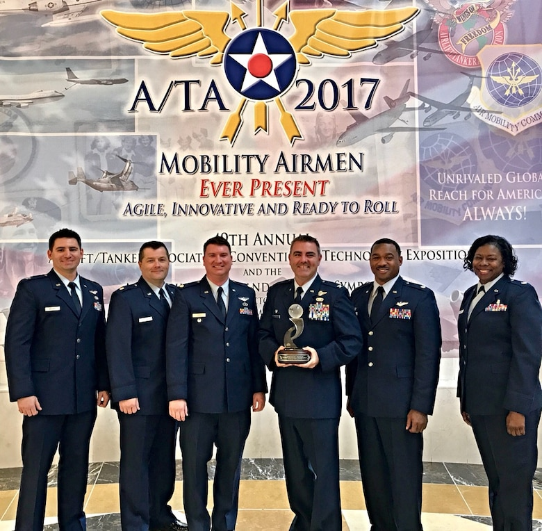 Members of the 403rd Operations Group accept the Airlift/Tanker Association's Lt. Gen. James E. Sherrard III Air Force Reserve Command Outstanding Unit Award. his award is presented annually to the most outstanding Air Force Reserve wing or group that distinguished itself in the performance and support of the Mobility Air Forces mission. (U.S. Air Force photo)
