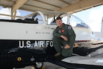 Maj. Joe Stallings, 558th Flying Training Squadron instructor pilot, with a T-6 Texan II on the flight line at Joint Base San Antonio-Randolph, Texas, Oct. 30, 2017.  Stallings was inspired to serve in the Air Force after attending air shows as a child and is the 2017 JBSA Air Show and Open House director of air operations.