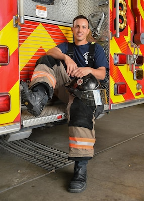 U.S. Air Force Senior Master Sgt. Thomas Turner, 153rd Airlift Wing first sergeant, sits on the back of a fire truck, Oct. 16, 2017, in Cheyenne, Wyoming.