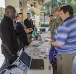 Experts in cybersecurity share information with USCENTCOM personnel during a cybersecurity awareness expo, October 26, 2017. The expo provided the opportunity for personnel and family members to talk with subject matter experts and view exhibits that highlight best security practices, in the workplace and home, to protect critical and personal information online.