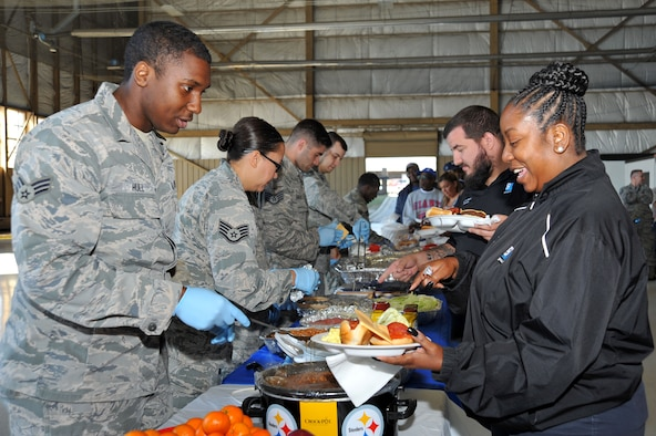U.S. Airmen assigned to the 20th Fighter Wing serve food to attendees at the 18th Annual AbilityOne Picnic at Shaw Air Force Base, South Carolina, Oct. 27, 2017.