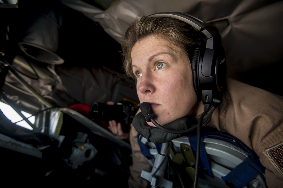 A boom operator concentrates as she prepares to refuel an aircraft.