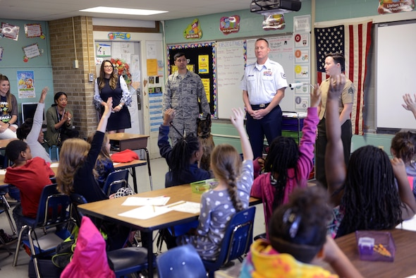 Military personnel from Little Rock Air Force Base, Ark., talk to Tolleson Elementary School students Oct. 26, 2017, during Red Ribbon Week activities.