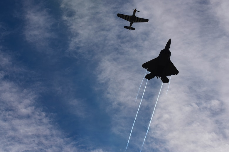 F-22 Raptor and P-51 Mustang fly side-by-side.