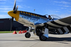 Pilot inside of P-51 Mustang about to take-off.