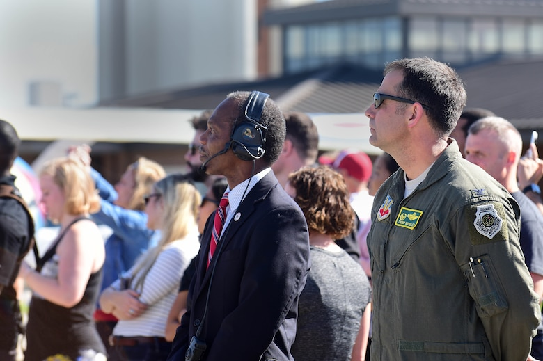 Donnie Tuck, City of Hampton mayor watches F-22 Raptor demonstration with crowd.