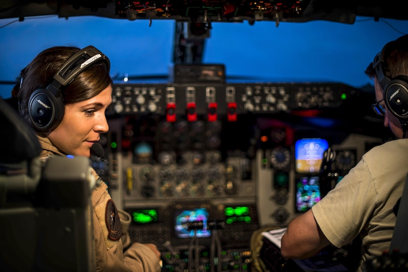 Two aircraft pilots fly an aircraft over Iraq.