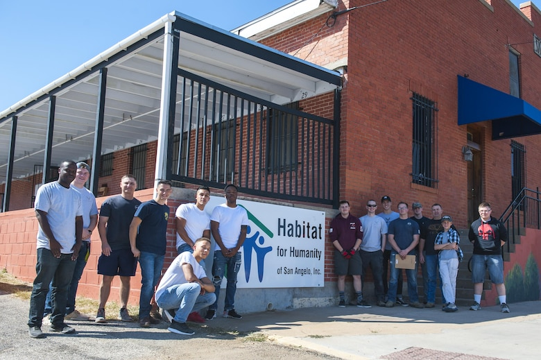 Members of the 17th Communications Squadron pose for a group photo outside of the Habitat for Humanity center in San Angelo, Texas, Oct. 26, 2017. Once a month, the 17th Communications Squadron pulls together and volunteers, and for October they chose Habitat for Humanity. (U.S. Air Force photo by Senior Airman Scott Jackson/Released)