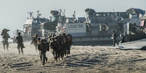 Marines disembark from an air-cushioned landing craft to begin the Red Beach tactical maneuvering.