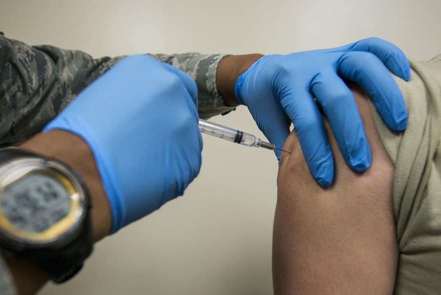 U.S. Air Force Senior Airman Tamika Bradley, 20th Medical Operations Squadron allergy and immunizations technician, injects a vaccine into a patient at Shaw Air Force Base, South Carolina, Oct. 23, 2017.