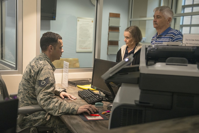 U.S. Air Force Tech. Sgt. Richard Sangston, 20th Medical Operations Squadron immunizations clinic noncommissioned officer in charge, helps patients at the front desk of the immunizations clinic at Shaw Air Force Base, South Carolina, Oct. 23, 2017.