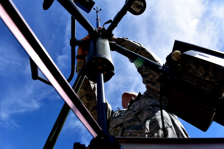 Staff Sgt. Jason Parsons, 19th Operations Support Squadron NCO in charge of the weather flight, assembles a Tactical Meteorological Observing System Oct. 23, 2017, at Little Rock Air Force Base, Ark. The system is capable of reading multiple aspects of weather including: wind direction, cloud height, temperature and dew point. (U.S. Air Force photo by Airman Rhett Isbell)