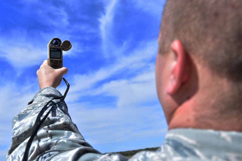 Staff Sgt. Jason Parsons, 19th Operations Support Squadron NCO in charge of the weather flight, checks weather conditions with a Kestrel weather meter Oct. 23, 2017, at Little Rock Air Force Base, Ark. The Kestrel weather meter is capable of measuring temperature, wind speed, air pressure and other weather conditions. (U.S. Air Force photo by Airman Rhett Isbell)