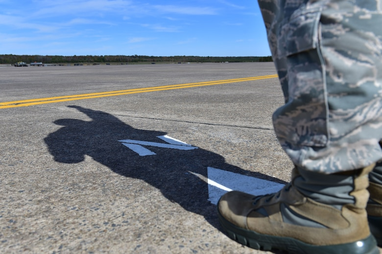 Staff Sgt. Jason Parsons, 19th Operations Support Squadron NCO in charge of the weather flight, holds up the Kestrel weather meter to take measurements of weather conditions Oct. 23, 2017, at Little Rock Air Force Base, Ark. Parsons measures the weather conditions from a part of the flight line marked north because facing north gives the most accurate weather readings at this latitude. (U.S. Air Force photo by Airman Rhett Isbell)