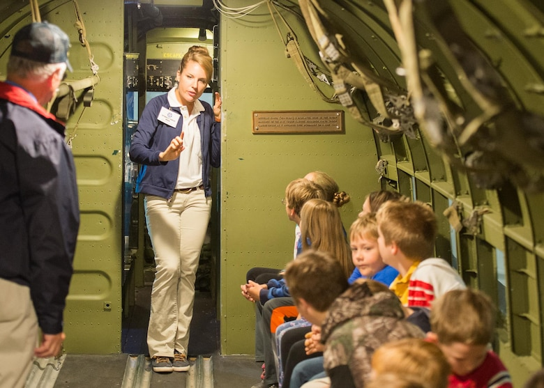 Tricia Upchurch, Air Mobility Command Museum volunteer educator, gives visiting students and parents a tour of a Curtiss C-47 airplane Oct. 17, 2017, at the Air Mobility Command Museum on Dover Air Force Base, Del.