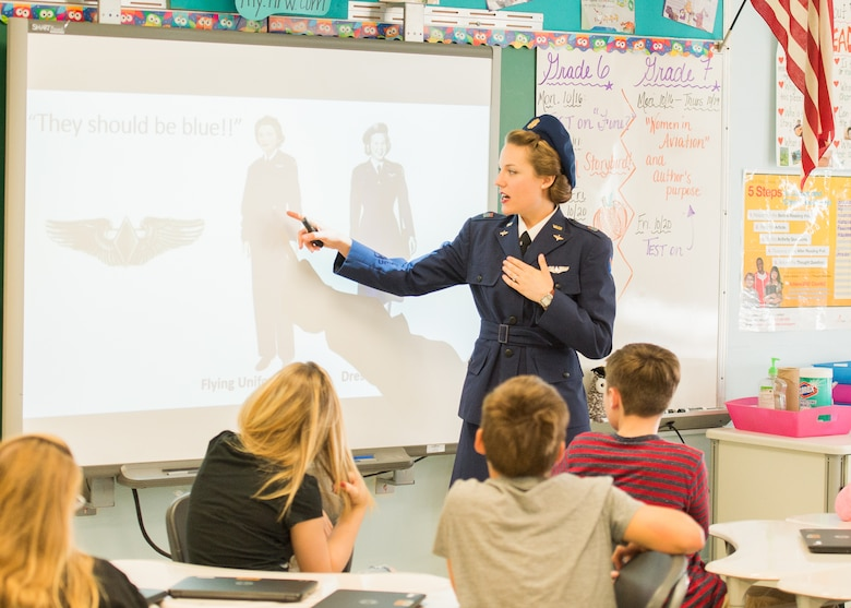 Tricia Upchurch, Air Mobility Command Museum volunteer educator, gives a history lesson to a class of 7th graders Oct. 19, 2017, at Dover Air Force Base Middle School on Dover Air Force Base, Del.