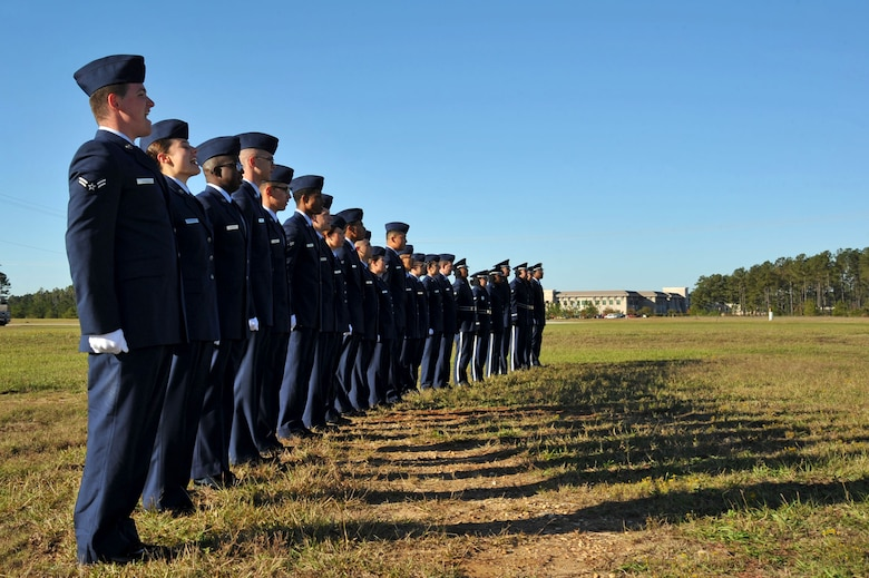 U.S. Airmen temporarily assigned to the 20th Force Support Squadron Honor Guard sing the Air Force Song after an honor guard graduation at Shaw Air Force Base, South Carolina (S.C.), Oct. 30, 2017.