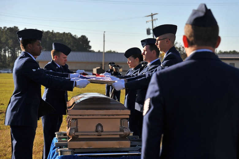 U.S. Airmen temporarily assigned to the 20th Force Support Squadron Honor Guard perform a simulated funeral detail during an honor guard graduation at Shaw Air Force Base, South Carolina, Oct. 30, 2017.