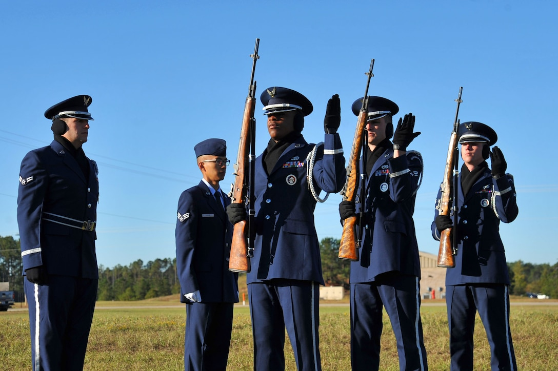 U.S. Airmen temporarily assigned to the 20th Force Support Squadron Honor Guard participate in a firing detail during a simulated funeral at an honor guard graduation at Shaw Air Force Base, South Carolina, Oct. 30, 2017.