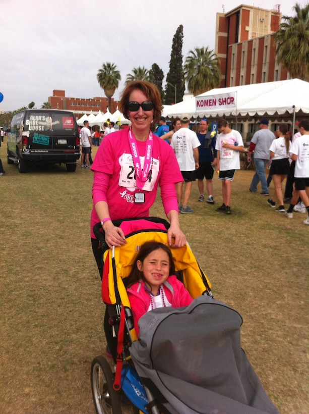 Col. Theresa Medina, 319th Medical Group commander, and her daughter Sophia, pose for a photo after participating in the Susan G. Komen Race for the Cure event April 1, 2014. Medina was diagnosed with stage one breast cancer in 2011 and overcame the illness with the help of Tricare and the support of family and friends. (Courtesy photo)