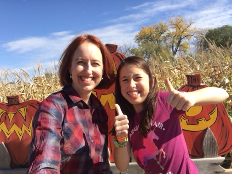 Col. Theresa Medina, 319th Medical Group commander, and her daughter Sophia, pose for a photo at a harvest festival Oct. 7, 2017 at Grand Forks, North Dakota. Medina was diagnosed with stage one breast cancer on Nov. 3, 2011, but with the help of Tricare and the support of family and friends she is now cancer free. (Courtesy photo)