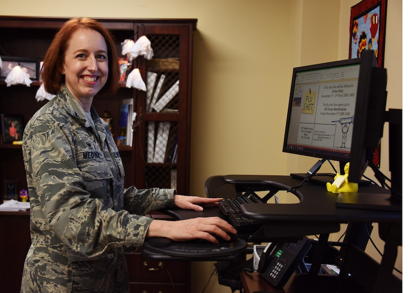 Col. Theresa Medina, 319th Medical Group commander, poses for a photo at her desk Oct. 30, 2017, at Grand Forks Air Force Base, North Dakota. Medina was diagnosed with stage one breast cancer a few years ago and overcame the illness with the help of Tricare and the support of family and friends. (U.S. Air Force photo by SrA Cierra Presentado)