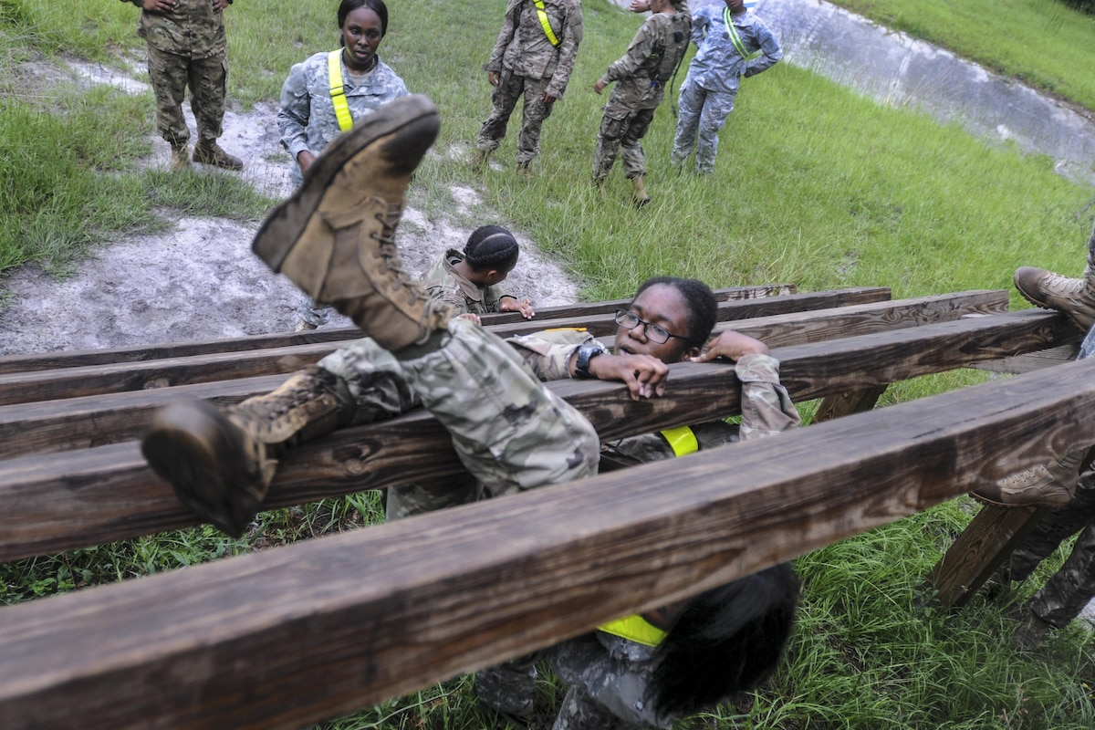 A soldier weaves her way through an obstacle.