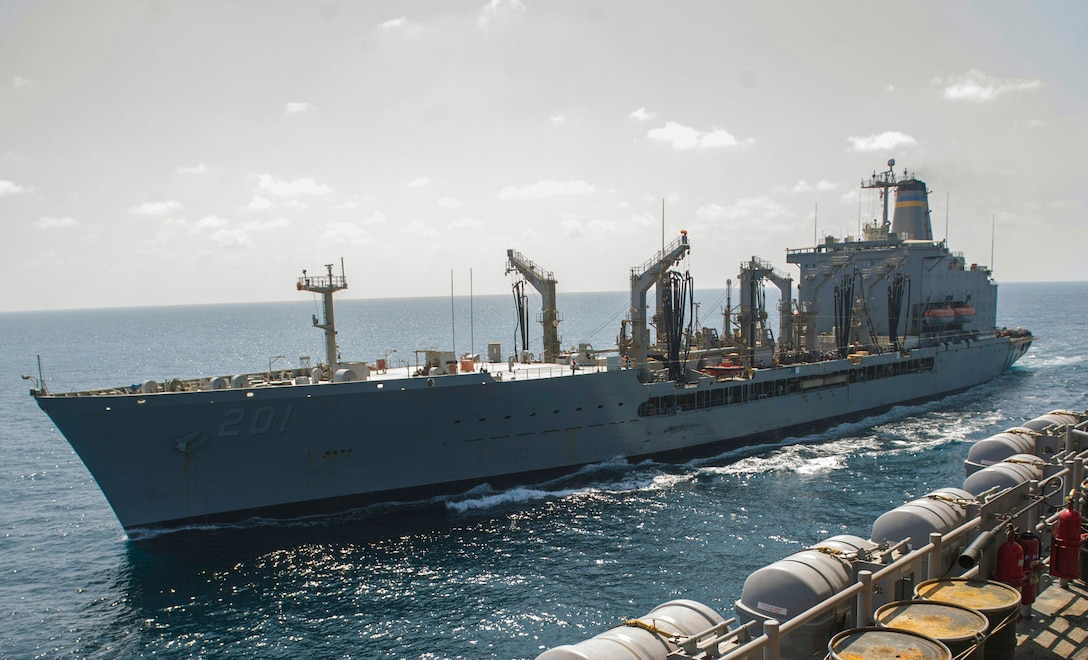 171028-N-GC965-204 5TH FLEET AREA OF OPERATIONS (Oct. 28, 2017) The fleet replenishment oiler USNS Patuxent (T-AO 201) steams alongside the amphibious assault ship USS America (LHA 6) in preparation for a replenishment-at-sea evolution. America is the flagship for the America Amphibious Ready Group and, with the embarked 15th Marine Expeditionary Unit, is deployed to the U.S. 5th Fleet area of operations in support of maritime security operations to reassure allies and partners and preserve the freedom of navigation and the free flow of commerce in the region. (U.S. Navy photo by Mass Communication Specialist 2nd Class Ramon Go/Released)