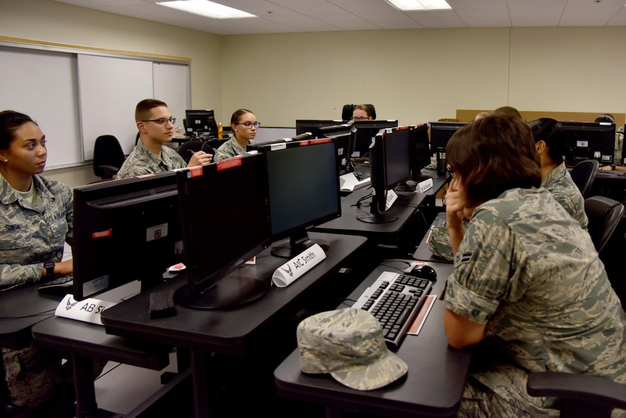 315th Training Squadron students sit in one of the old-style classrooms at the Di Tomasso Hall on Goodfellow Air Force Base, Texas, June 21, 2017. The 315th TRS is currently in the process of updating its classrooms to foster a better learning environment for students. (U.S. Air Force photo by Staff Sgt. Joshua Edwards/Released)