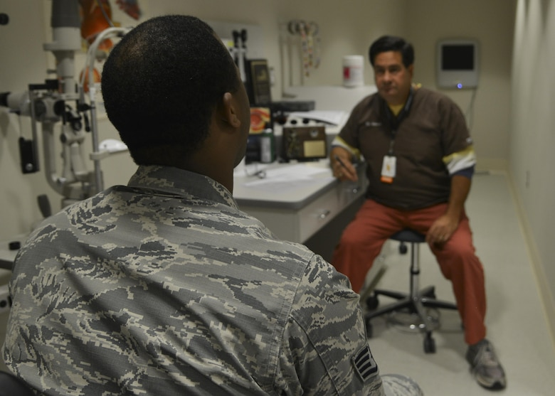 From right, Dr. William Velardi, 633rd Aerospace Medicine Squadron optometrist, assesses a patient's eye health at Joint Base Langley-Eustis, Va., Oct. 3, 2017.