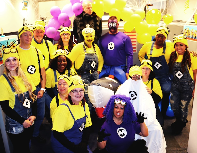 "Members of the 21st Contracting Squadron Infrastructure Flight dressed as characters from the movie series ""Despicable Me"" Oct. 31, 2017 at Peterson Air Force Base, Colorado. Members were encouraged to dress in costume to celebrate Halloween. (U.S. Air Force photo by Staff Sgt. Erica Picariello)"