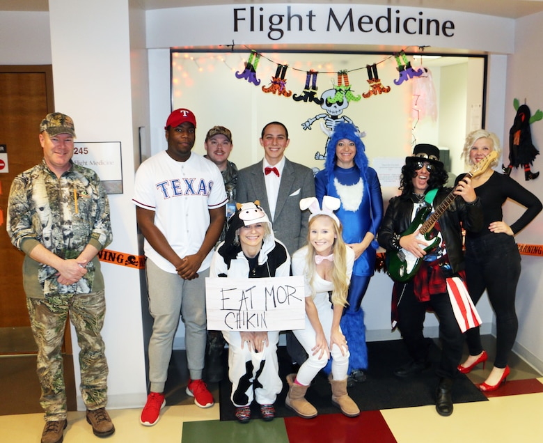 Members of the 21st Medical Group's Flight Medicine Flight dress in character for Halloween at Peterson Air Force Base, Colorado, Oct. 31, 2017. Some units on Peterson AFB dressed in costume to celebrate Halloween. (U.S. Air Force photo by Staff Sgt. Erica Picariello)