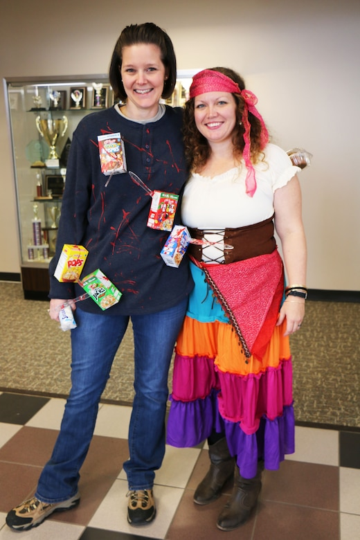 "Maser Sgt. Michelle James, 21st Comptroller Squadron finance flight chief ""cereal killer,"" poses with 2nd Lt. Danielle Sease, 21st Comptroller Squadron finance flight commander ""gypsy"" inside of the 21st Mission Support Group building Oct. 31, 2017 at Peterson AFB. Members were encouraged to dress in costume to celebrate Halloween. (U.S. Air Force photo by Staff Sgt. Erica Picariello)"