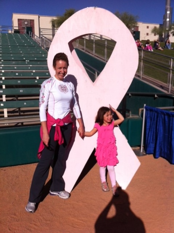 Col. Theresa Medina, 319th Medical Group commander, and her daughter Sophia, pose for a photo Oct. 28, 2012. Medina was diagnosed with stage one breast cancer in 2011, and, with the help of Tricare and the support of her family and friends, she overcame the illness and is now cancer free. (Courtesy photo)