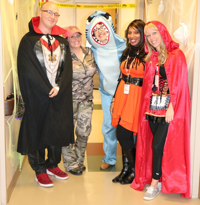 Members of the 21st Medical Group Family Health Team C show-off their costumes while in the medical group Oct. 31, 2017 at Peterson AFB. Members were encouraged to dress in costume to celebrate Halloween. (U.S. Air Force photo by Staff Sgt. Erica Picariello)