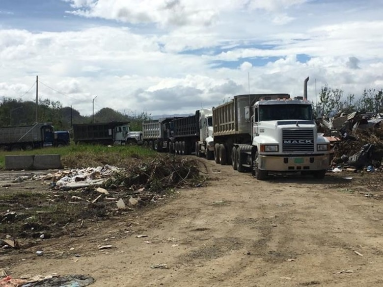 A local contractor hired by the U.S. Army Corps of Engineers disposes of debris left by Hurricane Maria at a landfill.
