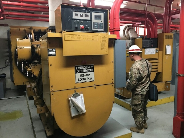 A prime power specialist assigned to 249th Engineer Battalion records information from a recently installed generator.