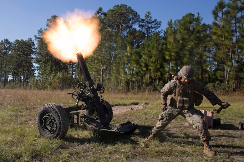 A Marine pulls a cord to fire a 120-mm mortar as part of Exercise Bold Alligator at Camp Lejeune, N.C. Oct. 23, 2017. Bold Alligator is designed to showcase the capabilities of the Navy-Marine Corps team, and demonstrate our cohesion with allied nations. The U.S. Marines and British troops gained camaraderie through integrated training, allowing them to familiarize themselves with each other's capabilities. (U.S. Marine Corps Photo by Pfc. Nicholas Guevara)
