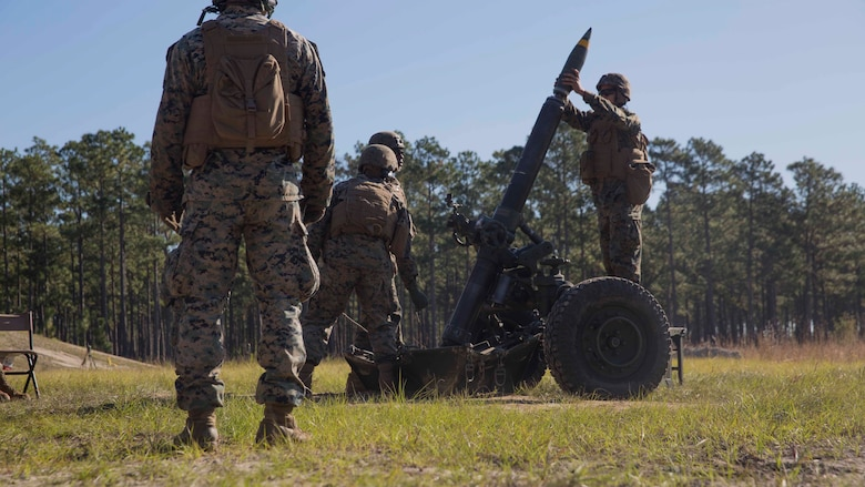 Marines load a round into a 120-mm mortar as they prepare to fire down range as part of Exercise Bold Alligator at Camp Lejeune, N.C. Oct. 23, 2017. Bold Alligator is designed to showcase the capabilities of the Navy-Marine Corps team, and demonstrate our cohesion with allied nations. The U.S. Marines and British troops gained camaraderie through integrated training, allowing them to familiarize themselves with each other's capabilities. (U.S. Marine Corps Photo by Pfc. Nicholas Guevara)