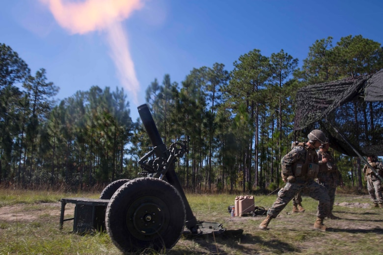 A Marine fires a 120-mm mortar downrange during a life-fire artillery exercise as part of Exercise Bold Alligator at Camp Lejeune, N.C. Oct. 23, 2017. Bold Alligator is designed to showcase the capabilities of the Navy-Marine Corps team, and demonstrate our cohesion with allied nations. The U.S. Marines and British troops gained camaraderie through integrated training, allowing them to familiarize themselves with each other's capabilities. (U.S. Marine Corps Photo by Pfc. Nicholas Guevara)