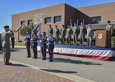 Langley Air Force Base Honor Guard members present the colors during the 1st Fighter Wing's 100-year monument unveiling ceremony at Joint Base Langley-Eustis, Va., Oct. 27, 2017.