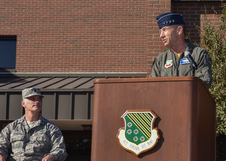 U.S. Air Force Gen. Mike Holmes, Air Combat Command commander, gives a speech during the 1st Fighter Wing's 100-year monument unveiling at Joint Base Langley-Eustis, Va., Oct. 27, 2017.