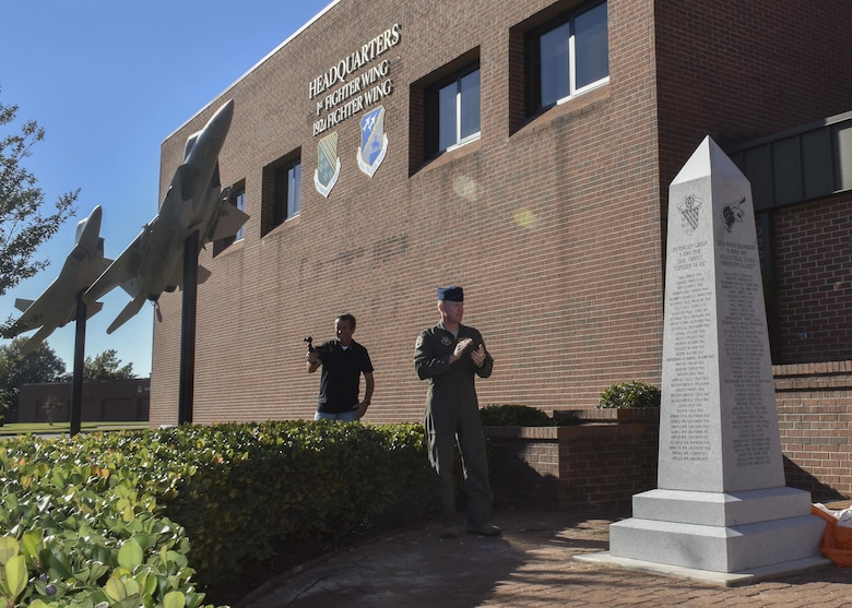 U.S. Air Force Col. Jason Hinds, 1st Fighter Wing commander, unveils the 100-year monument as part of the 1st FW's centennial celebration at Joint Base Langley-Eustis, Va., Oct. 27, 2017.