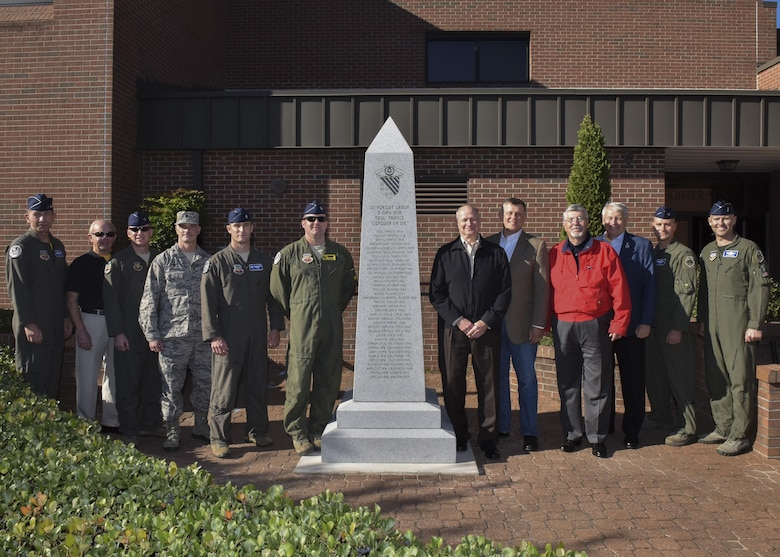 U.S. Air Force commanders and civilian representatives attending the 1st Fighter Wing's 100-year monument ceremony pose for a group photo at Joint Base Langley-Eustis, Oct. 27, 2017.