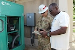 Army Staff Sgt. Jerry Hoover, a pre-installation inspection team member with the 249th Engineer Battalion, assesses a Cotton Valley Fire Department generator.