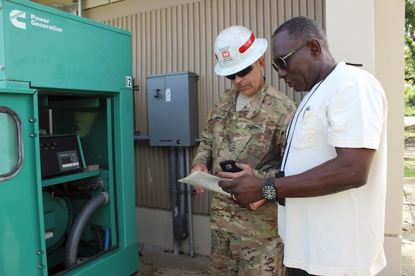 Army Staff Sgt. Jerry Hoover, a pre-installation inspection team member with the 249th Engineer Battalion, assesses a Cotton Valley Fire Department generator with a facility staff member in St. Croix, U.S. Virgin Islands, Oct. 29, 2017. The 249th Engineer Battalion and the U.S. Army Corps of Engineers Tulsa District power team are working together to complete more than 25 generator assessments for private facility generators. Army photo by Rebecca Nappi