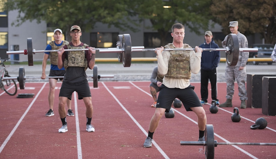 Airmen from the 366th Civil Engineer Squadron explosive ordnance disposal unit lift weights at the EOD memorial workout Sept. 29, 2017, at Mountain Home Air Force Base, Idaho. The workout was performed in remembrance of all the EOD technicians who lost their lives after Sept. 11, 2001. (U.S. Air Force photo by Airman 1st Class Alaysia Berry)